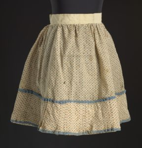 This simple slave girl's flowered skirt was hand-sewn with a whipstitch using natural thread.